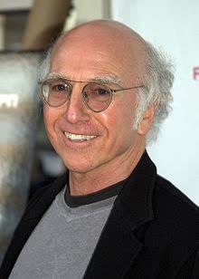Une personne portant des lunettes et souriant à la caméra Description générée automatiquement